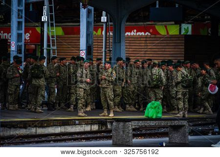 Romanian Soldiers Waiting For A Train On The Platform Of Bucharest North Railway Station (gara De No