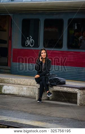 Woman Sitting On A Bench, Waiting A Train On The Platform Of Bucharest North Railway Station (gara D