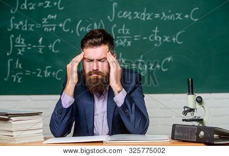 Terrible Headache. Teacher Has Headache. Bearded Man Suffer From Headache. Headache And Migraine. He