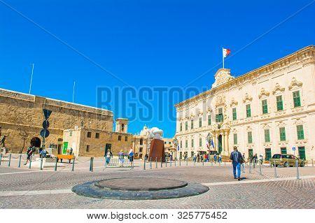 Valletta, Malta - 30 March 2019: The Auberge De Castille With Old Traditional Baroque Architecture B