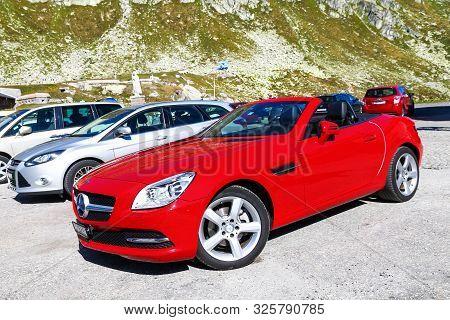 Saint Gotthard Pass, Switzerland - September 13, 2019: Red Convertible Car Mercedes-benz Slk-class (