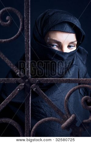 The arabic woman in a black coverlet. poster