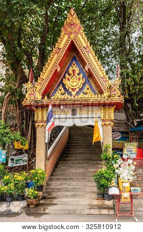 Si Racha, Thailand - March 16, 2019: Red, Gold, Blue Gate On Stairway To Wat Koh Loy Buddhist Shrine
