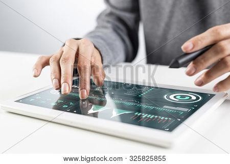 Man In White Business Suit Using Tablet Computer. Close-up Of Male Hands Holding Pen And Tablet Gadg