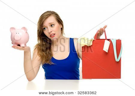 Woman with piggy bank and shopping bags