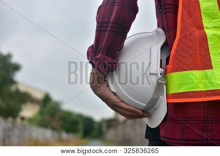 Engineer Holding Hard Hat Safety At Work Place And Building Development Estate Heavy Architecture Co