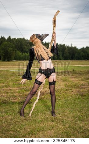 Seminude Woman In Sexy Underwear With Raven Mask On The Head