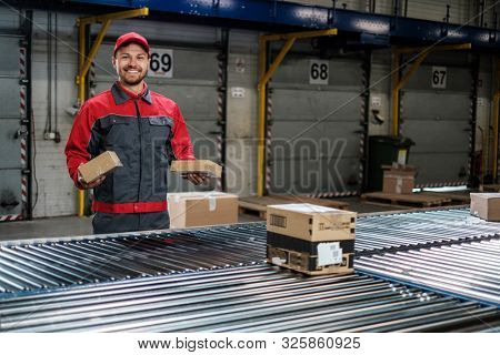 Warehouse worker working on a conveyor line