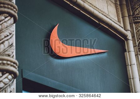 Nike Logo Brend Sign On City Street. Signboard Of Nike Logo On Store, Shop, Mall, Boutique. Kiev, Uk
