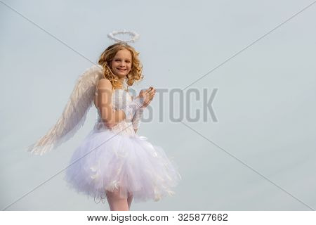 Cherub Angel Pray. The God Of Love. Portrait Of Little Curly Blond Angel Girl. Love Card. Angel Chil