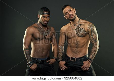 Look At The Tattoo We Got. Muscular Men With Fashionable Tattoo Style. Sexy Men With Muscular Torso.