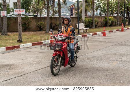 Si Racha, Thailand - March 16, 2019: Man With Orange Vest Rides Red Honda Motorcycle On Ko Loi Islan