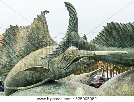Si Racha, Thailand - March 16, 2019: Closeup Of Statues Of Bronze Swordfishes In Koh Loy Park Founta