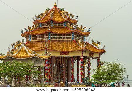 Si Racha, Thailand - March 16, 2019: Closeup Of Red Roofed Guan Yin Circular Shrine On Edge Of Ko Lo