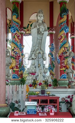 Si Racha, Thailand - March 16, 2019: Closeup Of Gray Statue Of Guan Yin In The Middle Of Her Open Ci