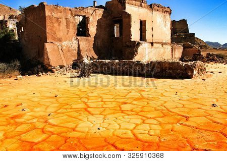 Colorful Orange Sediments Deposited In A Dry Lake Of An Old Abandoned Mine In Mazarron, Spain. Old A