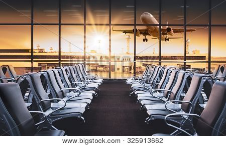 Empty Airport Terminal Lounge With Airplane On Background. Modern Airport Waiting Area With Flyinf A