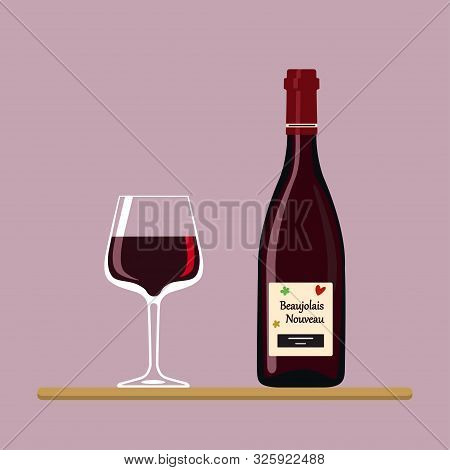 Beaujolais Nouveau. Bottle And Wine Glass With Beaujolais Nouveau Isolated On Pink Background