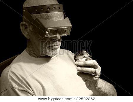 Man examining wristwatch