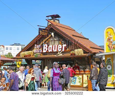 Stuttgart, Germany-september 30, 2018: Beer Festival, Festive Fairground And Rides