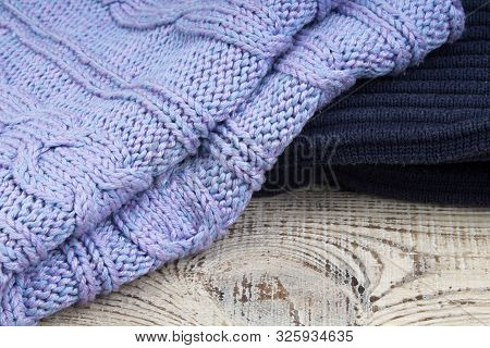 Knitted Wool Sweaters. Pile Of Knitted Winter Clothes On Wooden Background, Sweaters, Knitwear, Spac