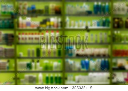 Blur Image Rows Of Hair Care Products On Display At Store. Cosmetic Products For Sale In Beauty Depa