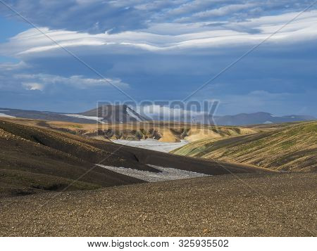 Colorful Rhyolit mountain panorma with snow fiields and multicolored volcanos in Landmannalaugar area of Fjallabak Nature Reserve in Highlands region of Iceland poster