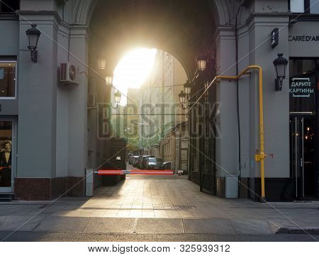 Moscow / Russia - October 03 2019: Street Petrovka. A Ray Of Sunshine Passes Through The Arch Of An