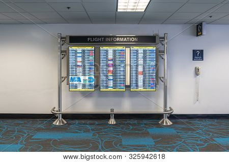 Miami, Usa - September 11, 2019: Monitor At Miami International Airport Lists Scheduled Departing Fl