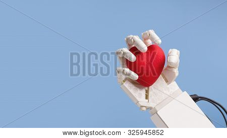 Life And Robotics Concept. Robot Hand Holding Red Heart, Blue Panorama Background With Empty Space