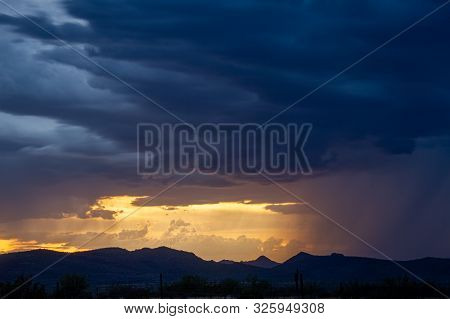 A Sunset Image Of A Monsoon In The Sonoran Desert Of Arizona.