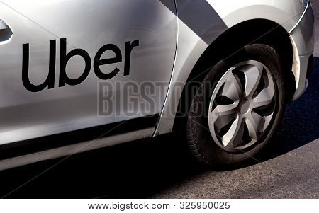 Bucharest, Romania - September 30, 2019: An Uber Logo Branded Car Is Seen In Traffic On A Street In