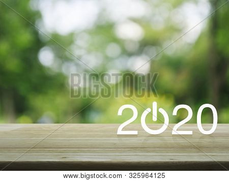 2020 Start Up Business Flat Icon On Wooden Table Over Blur Green Tree In Park, Happy New Year 2020 C