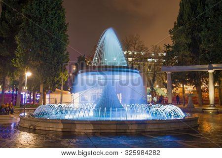 Baku, Azerbaijan - January 04, 2018: Fountain In Blue Backlight On Fountain Square. Night Baku