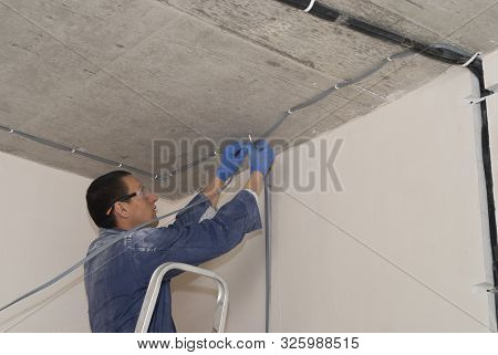 Electrician Laying Wire