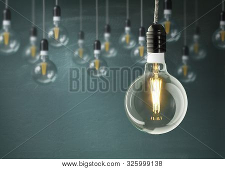 Hanging Light Bulbs With Glowing One Isolated On Dark Green Background