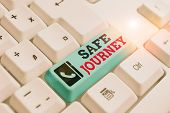 Text sign showing Safe Journey. Conceptual photo polite way of wishing someone a safe journey or Safe Travel White pc keyboard with empty note paper above white background key copy space. poster