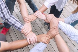 Teamwork Connection Success Concept. Group Of People Holding Hands Circle Together In The Park. Huma
