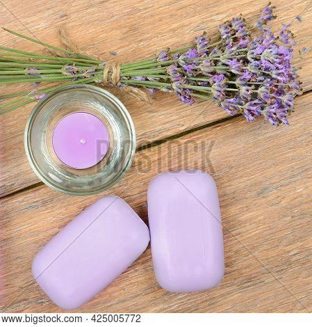 Spa Accessories: Lavender Soap, Scented Candle, Dried Lavender Flowers On A Wooden Background.