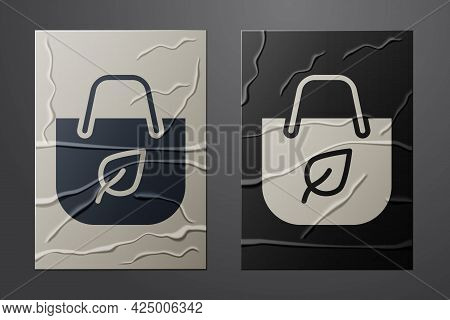 White Paper Shopping Bag With Recycle Icon Isolated On Crumpled Paper Background. Bag With Recycling