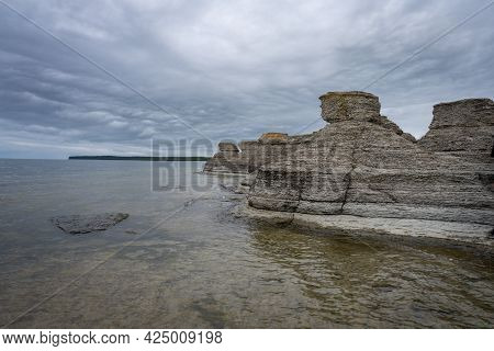 A Beautiful Limestone Formation With A Dramatic Sky In The Background. Picture From The Baltic Sea