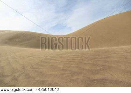 The Large Yellow Sand Dune Of The Singing Dune In Altyn-emel, The Wind Blows The Sand, On The Sand T
