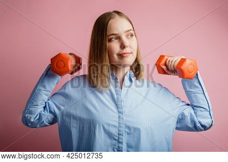 Strong Confident Business Woman Holding Dumbbells In Office Clothes Isolated Over Color Pink Backgro
