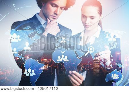 Businessman And Businesswoman Are Looking For New Talented Candidates For Corporate Company. Hologra