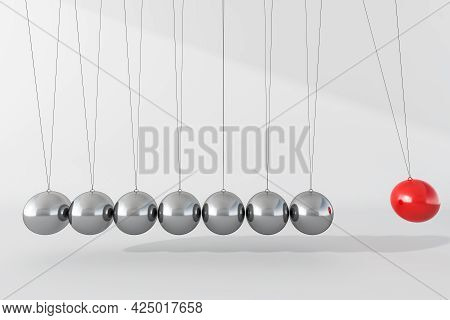 Newton Cradle Balance Balls. Seven Balls, Made Of Grey Steel, And The Edge One Coloured Red, Hanging