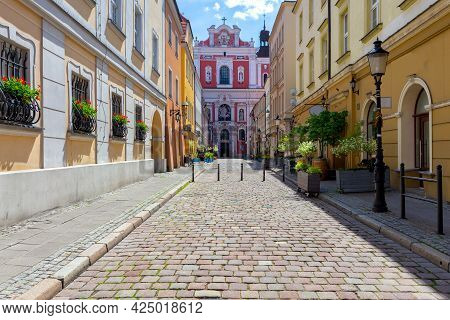 Poznan. Narrow Old Street With Famous Medieval Houses.