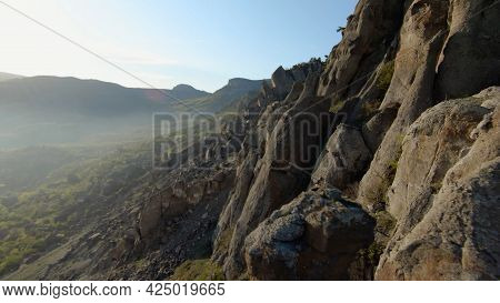 Beautiful Flight On Rocky Slopes Of Mountains. Shot. Mountain Slopes With Variety Of Rocky Formation