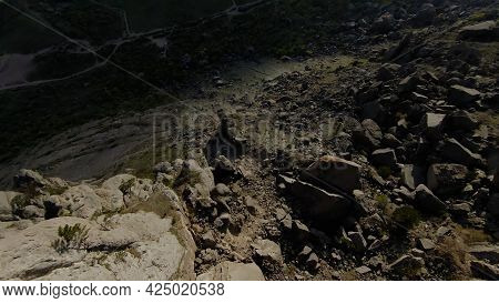 Standing Stones On Rocky Slopes. Shot. Variety Of Rock Formations And Erosion On Mountain Slopes. Fl