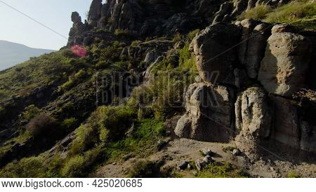Extreme Flight Between Mountain Rocks. Shot. Fast Flight At Rocky Formations On Mountain Slopes. Fly