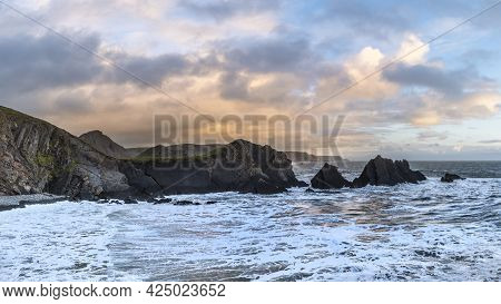 Stunning Landscape Image Of View From Hartland Quay In Devon England Durinbg Moody Spring Sunset